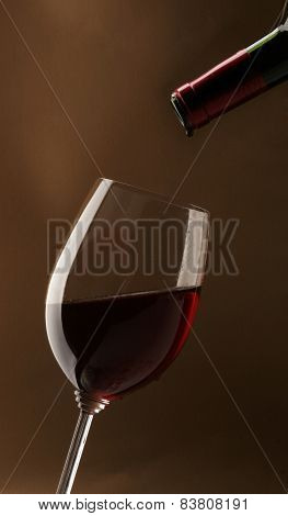 Red Wine On Brown Background