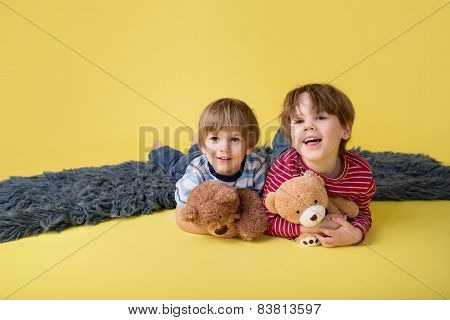 Happy Kids, Siblings, Hugging Stuffed Toys