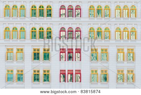 Red And Yellow Open Windows On Classical Building