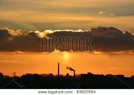 Sunset Over The City With Industry Pollution