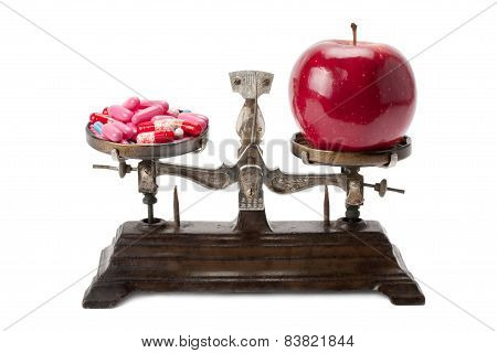 Medicine And An Apple On The Scales