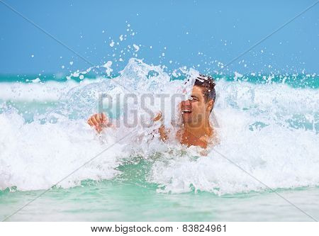 Handsome Man Enjoys Swimming In Sea Waves