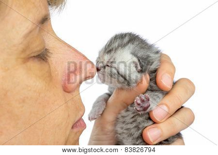 Female nose touching nose of young cat