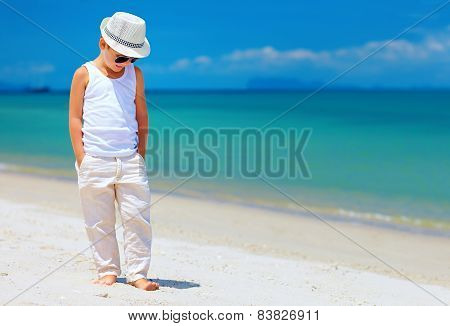 Stylish Kid Boy Walking The Tropical Beach