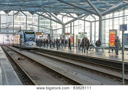 People Traveling With The Tram At The Central Station Of The Hague, The Netherlands