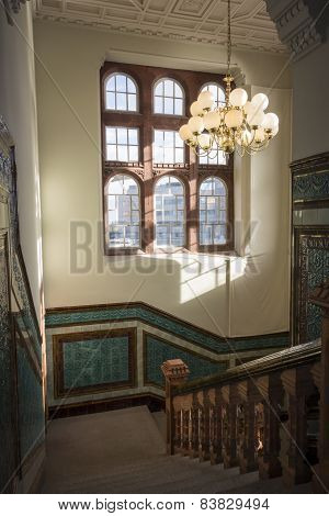 Granite Stairwell With Patterned Ceramic Tiles