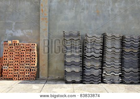 Stack Roofing Tiles And Red Brick For Building Construction