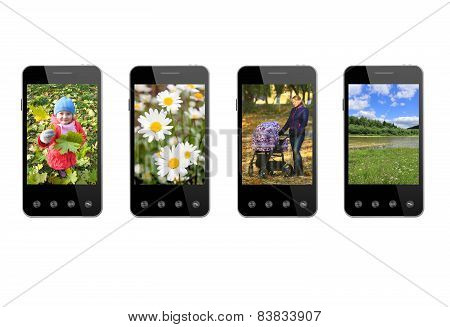 Four Smart-phones With Colored Images Isolated