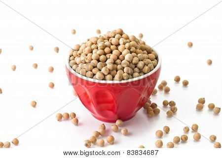 Small Chickpeas In A Red Bowl On A White Background