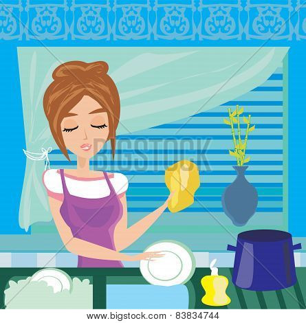 Housewife Washing The Dishes At Night