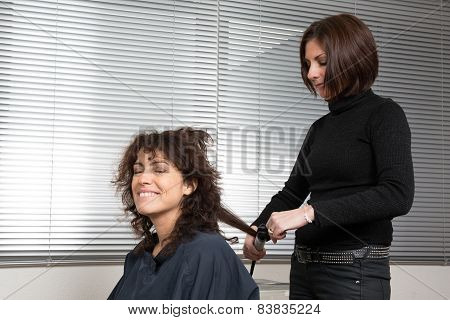 Woman at hairdresser