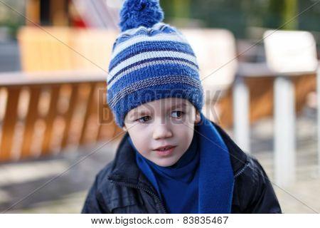 Little Curious Boy In Winter Cap