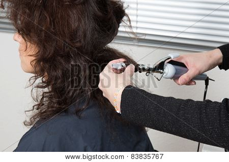 Close up of a hairdresser coloring woman's hair