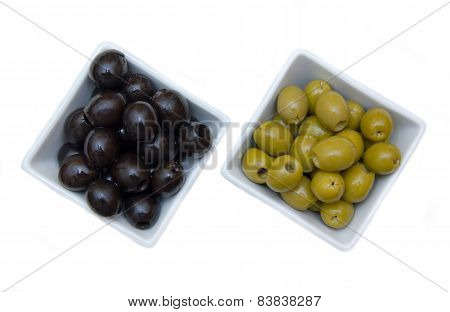 Bowls with green and black olives from above