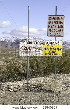 Desert reward sign for illegal dumping