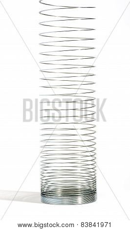 Metal Spring In Vertical On A White Background