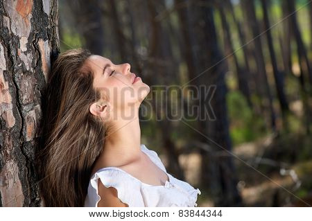 Beautiful Girl Looking Up With Eyes Closed In The Woods
