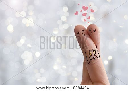 Conceptual finger art. Lovers is embracing and holding wine glasses. Stock Image