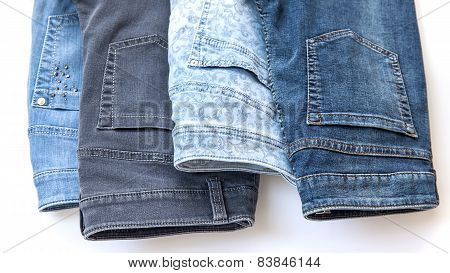 jeans of various colors on a counter in shop