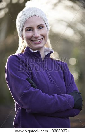 Portrait Of Woman On Winter Run Through Woodland
