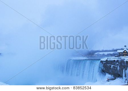 Welcome Center And Under The Falls With Horseshoe Fall In Winter
