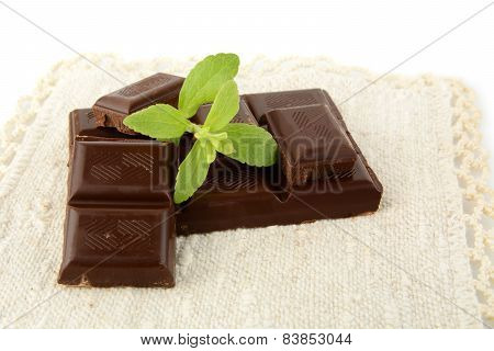 Group Of Blocks Of Chocolate With Sage On White Material