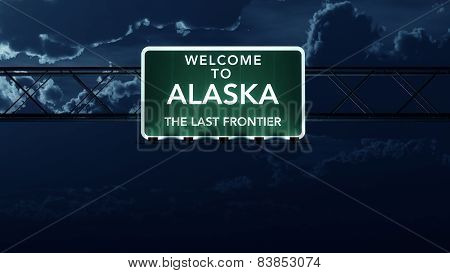 Alaska USA State Welcome to Interstate Highway Sign at Night