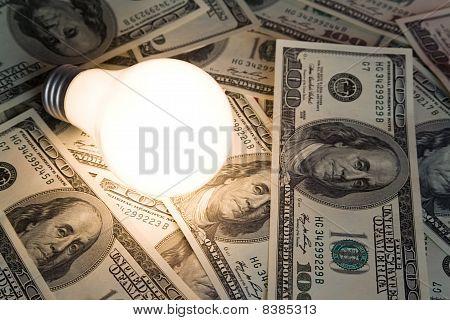 Bright Light Bulb And Dollar