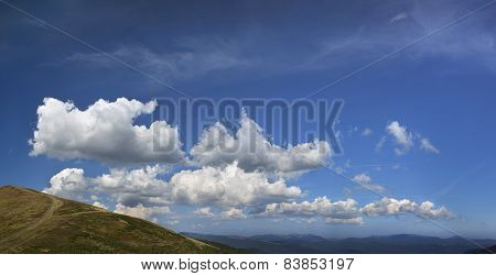 Clouds over the mountains in evening