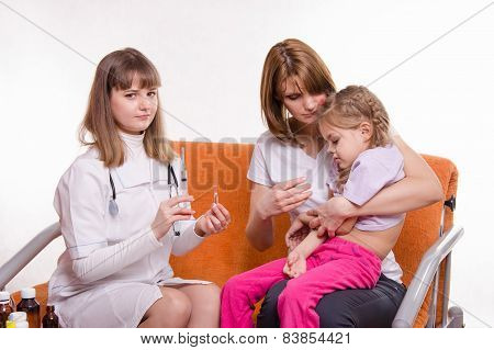 Pediatrician Is Going To Get A Shot Sick Child Sitting On Hands Of Mother