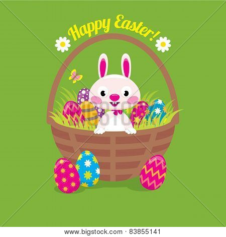 Easter Bunny In A Basket With Easter Eggs On A Green Background