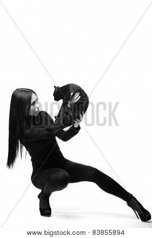 Women And Cats. Black And White Photo.