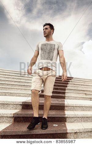 serious man walking downstairs in summer season