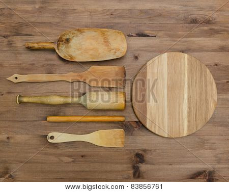 Wooden kitchen utensils  and cutting board on wooden table