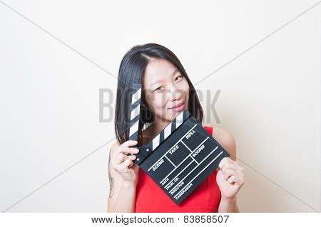 Young Beautiful Asian Woman Portrait Posing With Clapperboard