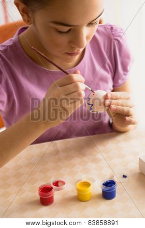 Closeup Shot Of Girl Painting Pattern On Easter Egg