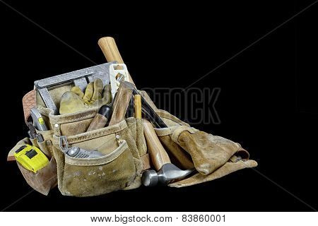 Rugged Leather Carpenters Work Bags And Construction Tools Isolated On Black Background
