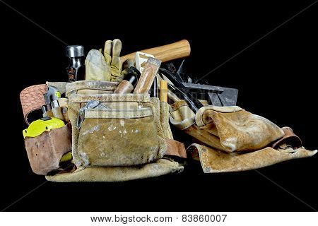 Rugged Leather Carpenters Work Bags With Trade Tools Isolated On Black Background