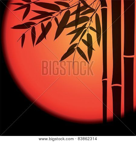 Bamboo trees and leaves with red sun on black background.