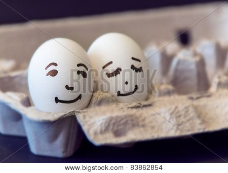 Love concept: eggs with painted faces on them