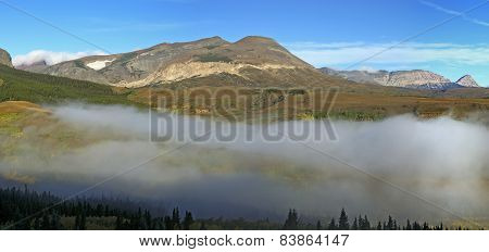 East Glacier Mountain Range With Valley Fog