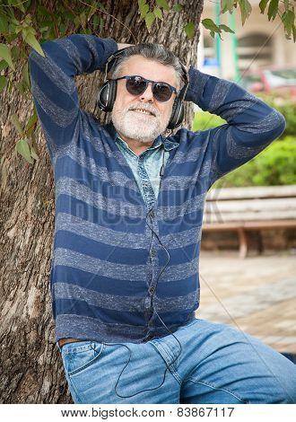 Man With Beard Listening To Music
