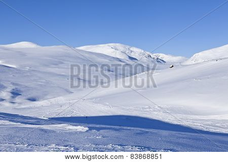 Snowmobile tracks in the Nordic mountains.