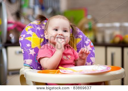 Pretty child toddler eating spaghetti