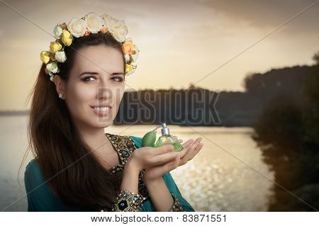 Young Woman Holding Perfume Bottle in Sunlight