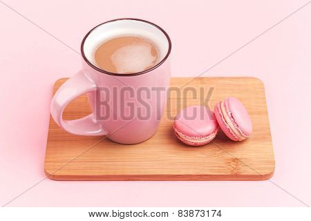 Pink macaroons with coffee