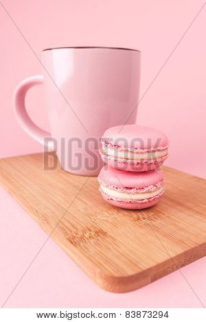 Pink macaroons on pink background