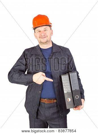 Man in hard hat holding folders