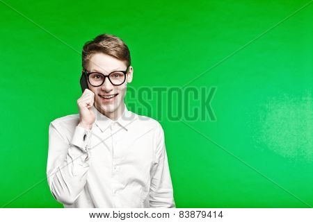 Young Man Talking By Phone And Smiliing