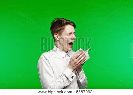 Young Man Sneezing And Running Nose
